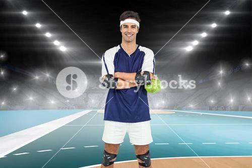 Composite image of sportsman standing with ball on white background