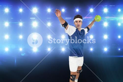 Composite image of portrait of sportsman throwing a ball
