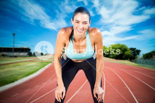 Composite image of sportswoman posing his hands on knee