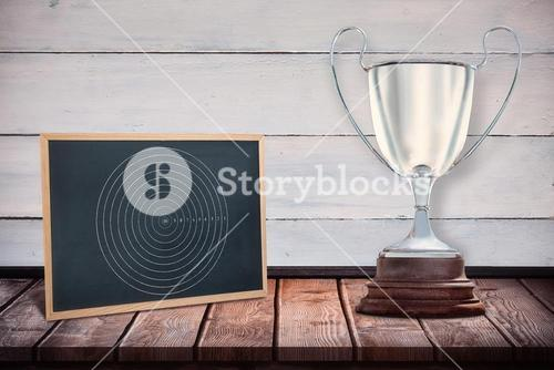 Focus on a trophy against black board