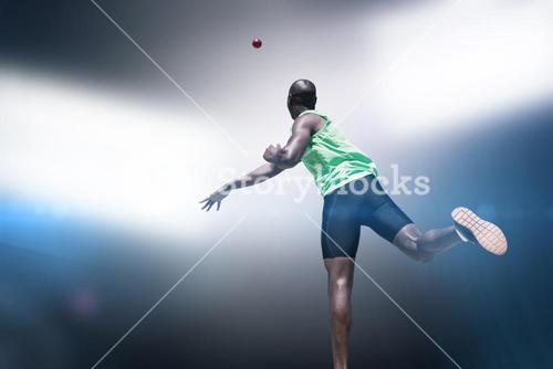 Rear view of sportsman throwing a shot
