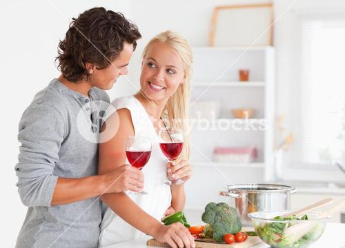 Couple having a glass of red wine