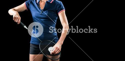 Badminton player holding a racquet ready to serve