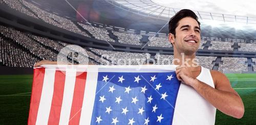 Composite image of athlete posing with american flag