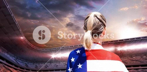 Composite image of rear view of american sportswoman is posing