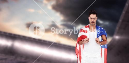Athlete with american flag wrapped around his body