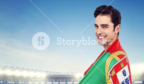 Athlete with portuguese flag wrapped around his body