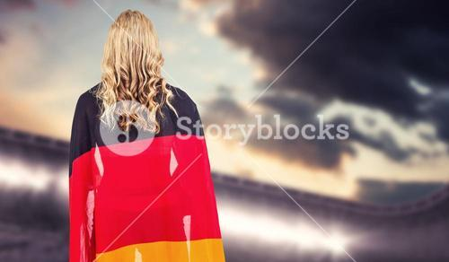 Composite image of athlete with german flag wrapped around her body