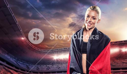 Athlete posing with german wrapped around her body