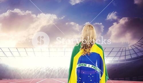 Athlete with brazilian flag wrapped around her body