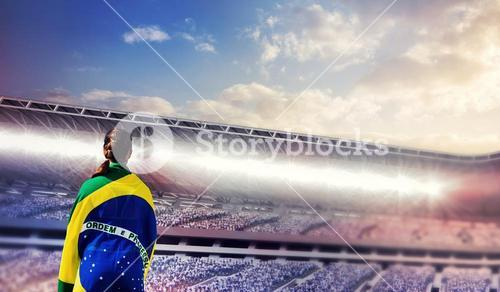 Composite image of rear view of sporty woman holding the brazilian flag