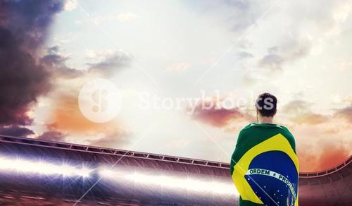 Composite image of rear view of brazilian sportsman