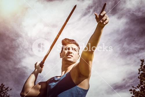 Composite image of low angle view of sportsman practising javelin throw