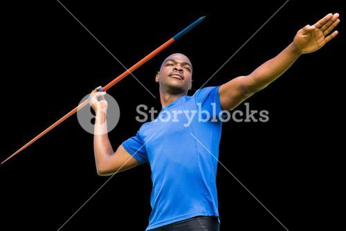Composite image of concentrated sportsman practising javelin throw