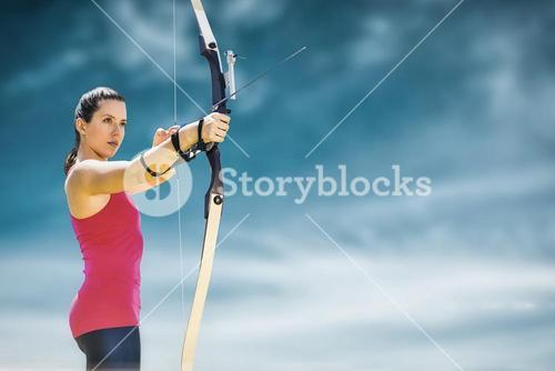 Composite image of sportswoman practicing archery on a white background
