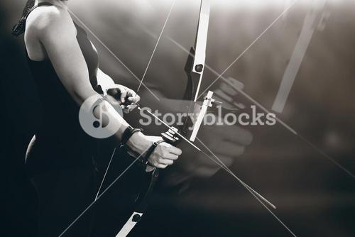 Composite image of sportswoman practicing archery