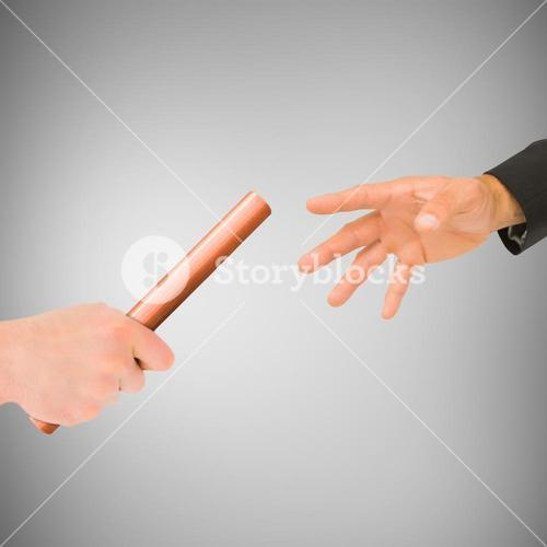 Athlete passing a baton to businessman