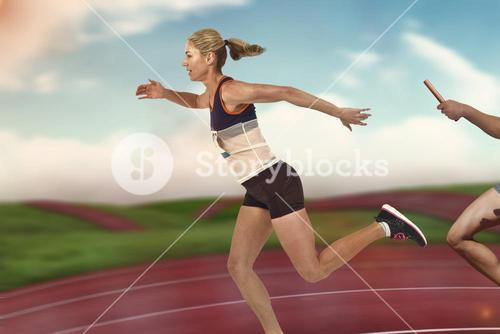 Composite image of athlete passing a baton to the partner