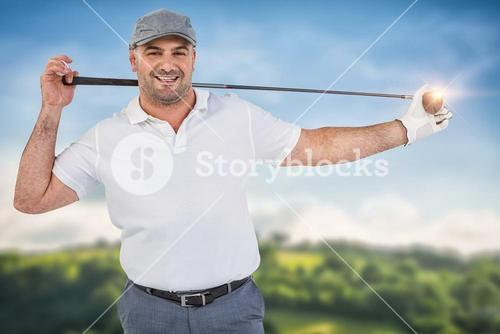 Composite image of portrait of golf player holding a golf club with rear view