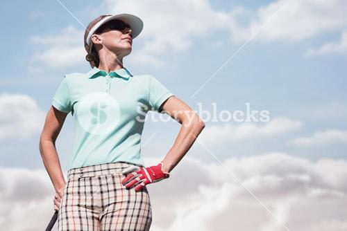 Focused woman playing golf