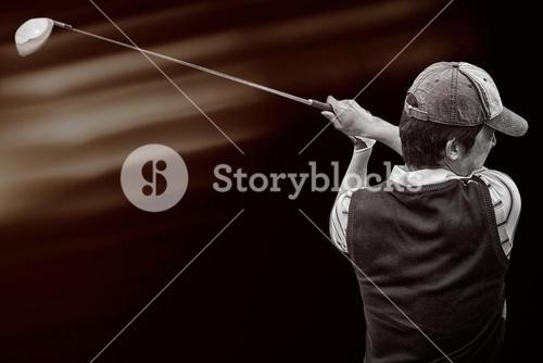 Portrait of golf player taking a shot