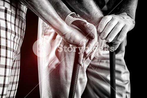 Composite image of hands holding golf club