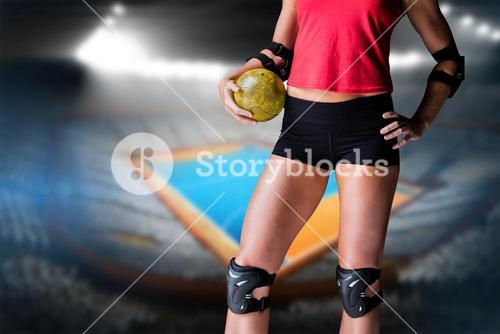 Female athlete with elbow pad holding handball