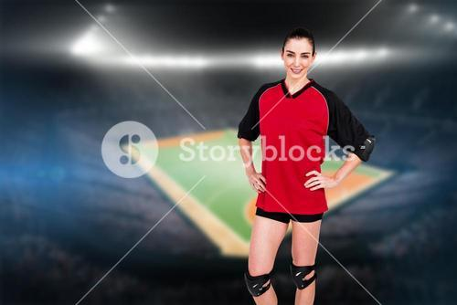 Female athlete posing with elbow pad and knee pad