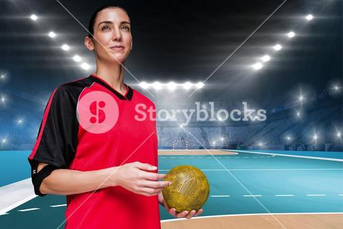 Composite image of female athlete holding a hand ball