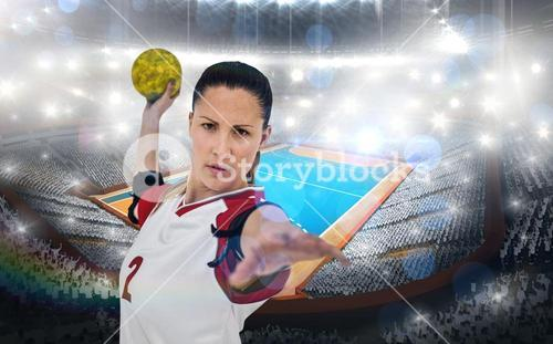 Composite image of sportswoman throwing a ball