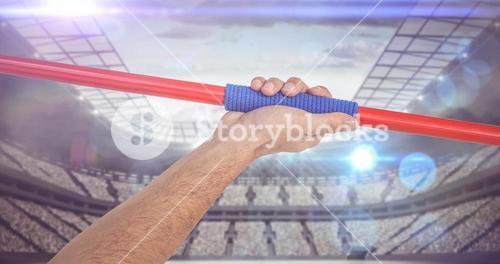Composite image of male athlete holding javelin