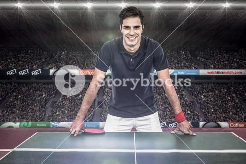 Composite image of confident male athlete leaning on hard table