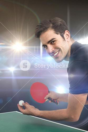 Composite image of portrait of happy male athlete playing table tennis