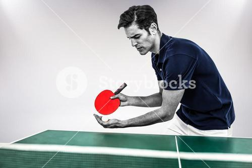 Composite image of confident male athlete playing table tennis