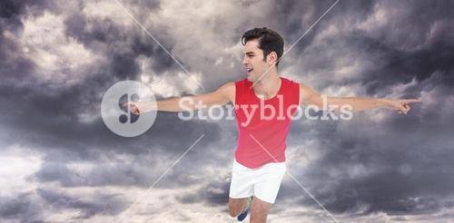 Composite image of excited male athlete with arms outstretched