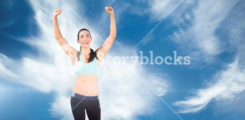 Sporty woman raising her arms