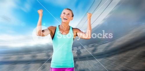 Composite image of athletic woman with arms up