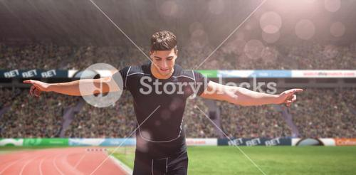 Composite image of front view of happy sportsman is running for the victory