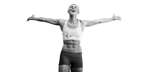 Fit woman celebrating victory with arms stretched