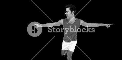 Excited male athlete with arms outstretched