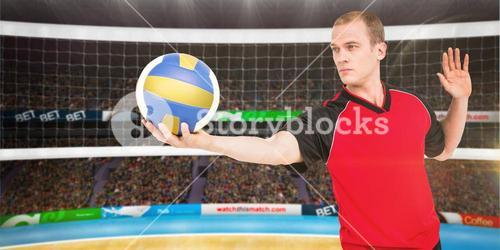 Composite image of sportsman getting ready to serve while playing volley ball