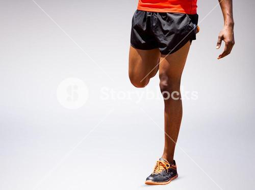 Composite image of athletic man hopping