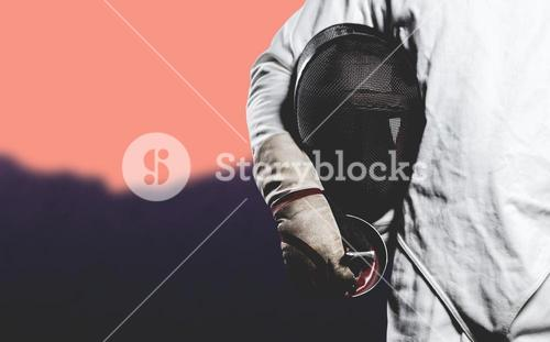 Composite image of mid-section of man standing with fencing mask