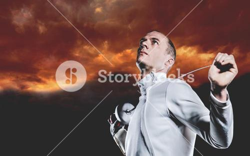 Composite image of swordsman holding fencing sword
