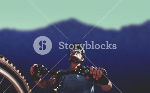 Composite image of man cycling with mountain bike