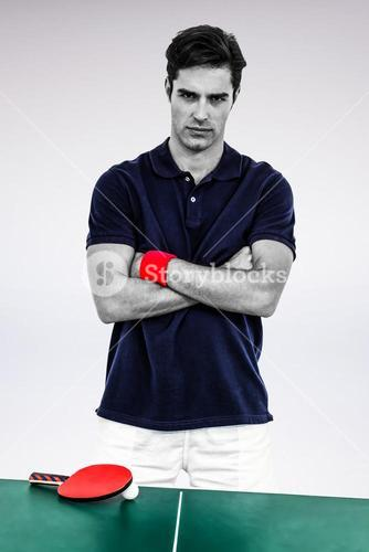 Composite image of portrait of male athlete standing with arms crossed