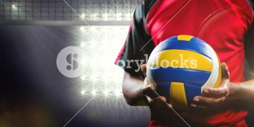 Composite image of mid-section of sportsman holding a volleyball