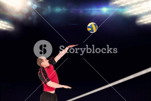 Composite image of sportsman hitting volleyball
