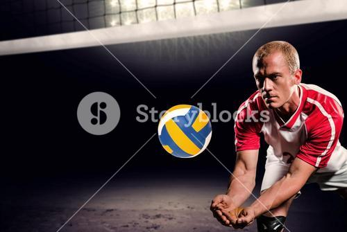 Composite image of sportsman diving while playing volleyball