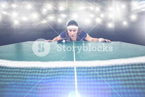 Composite image of confident female athlete leaning on hard table